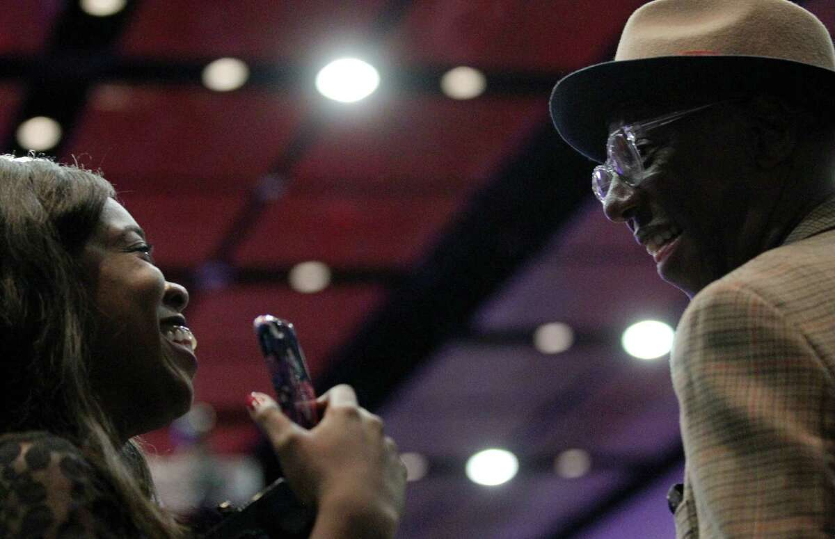 Michael Yarbrough, former city council member, right, talks with Melissa Thompson at the Sylvester Turner election night watch party at the George R. Brown Convention Center, Saturday, Dec. 12, 2015, in Houston.