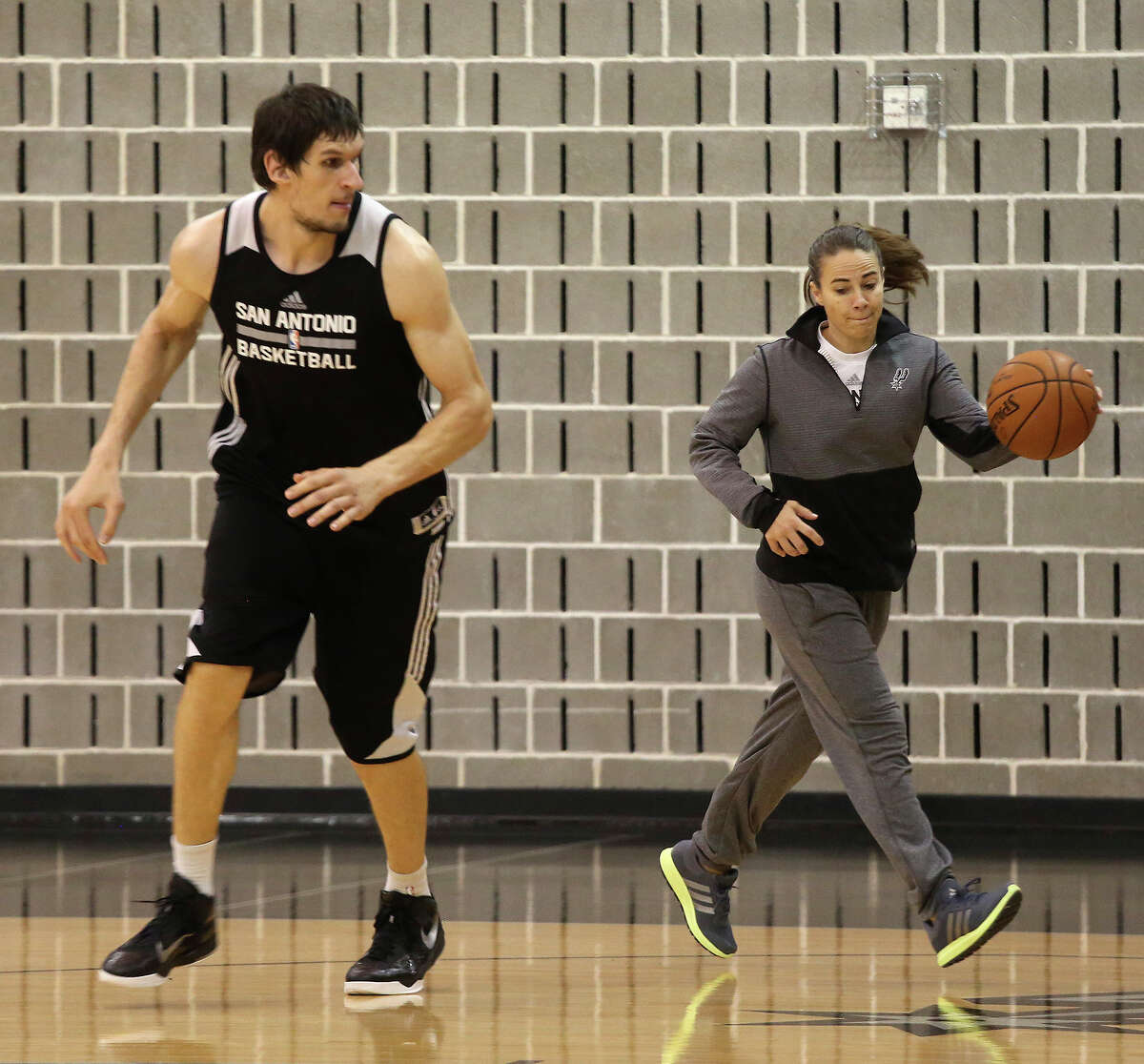 Spurs assistant coach Becky Hammon works with Boban Marjanovic at the Spurs practice facility on Nov. 25, 2015.