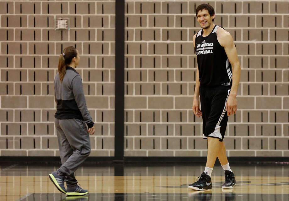 Spurs assistant coach Becky Hammon works with Boban Marjanovic at the Spurs practice facility on Nov. 25, 2015. Photo: Lisa Krantz /San Antonio Express-News / SAN ANTONIO EXPRESS-NEWS