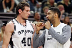Spurs' Boban Marjanovic talks with teammate Tim Duncan during second half action against the Pistons on Oct. 18, 2015 at the AT&T Center.