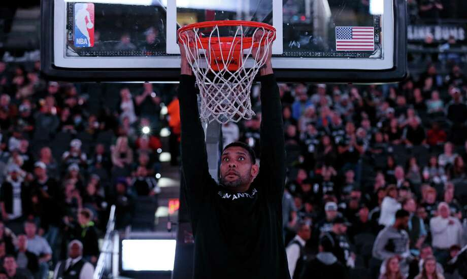 San Antonio Spurs' Tim Duncan hangs from the rim before the game with the Phoenix Suns on Nov. 23, 2015 at the AT&T Center. Photo: Edward A. Ornelas /San Antonio Express-News / © 2015 San Antonio Express-News