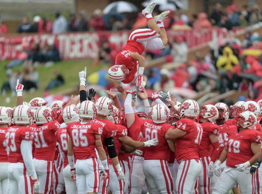 Joshua Chiu (33) of the Katy Tigers is tossed in the air by his teammates prior to the start of the second half against the Cinco Ranch Cougars in a high school football game on Saturday, November 7, 2015 at Rhodes Stadium. Photo: Wilf Thorne / © 2015 Houston Chronicle