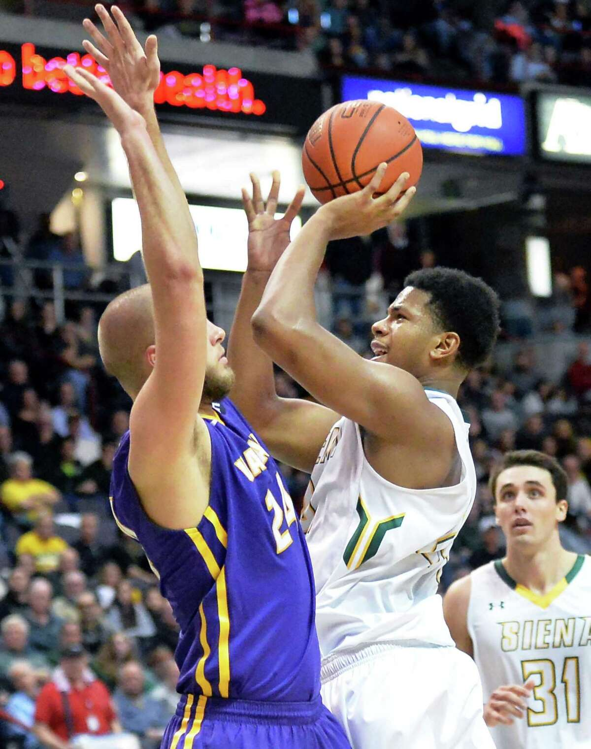 UAlbany's #24 Dallas Ennema, left, defends against Siena's #24 Lavon Long's shot during Saturday's game at the Times Union Center Dec. 12, 2015 in Albany, NY. (John Carl D'Annibale / Times Union)
