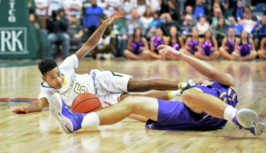Click through the photos see the results of the Albany Cup turned out from 2001 to 2017.Siena's #5 Kenny Wormley, left, and UAlbany's #3 Joe Cremo during Saturday's game at the Times Union Center Dec. 12, 2015 in Albany, NY.   (John Carl D'Annibale / Times Union) Photo: John Carl D'Annibale / 00034282A