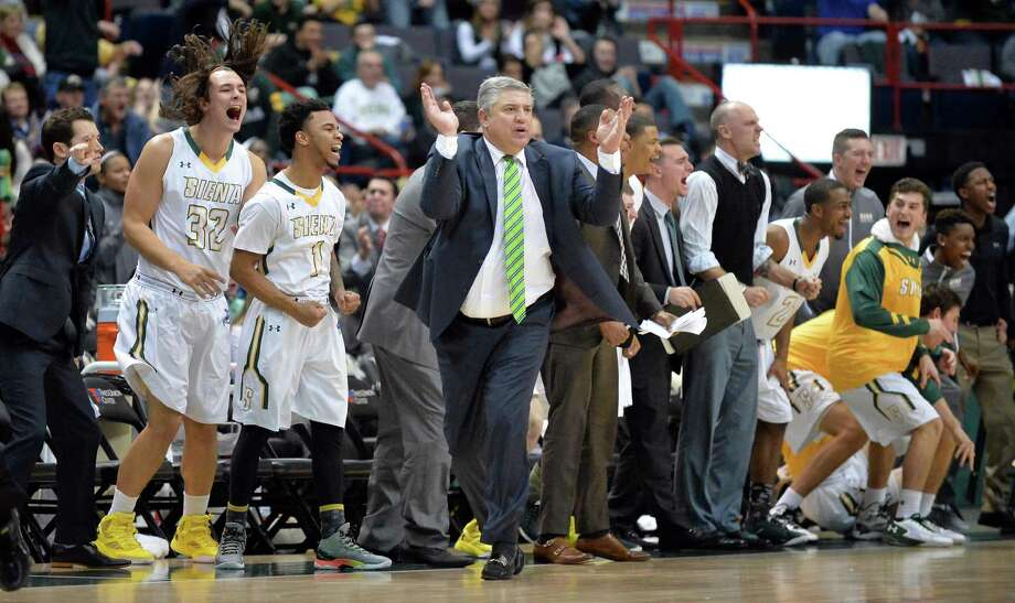 Head coach Jimmy Patsos, center, the Siena bench celebrate their win over UAlbany for the Albany Cup Saturday at the Times Union Center Dec. 12, 2015 in Albany, NY.   (John Carl D'Annibale / Times Union) Photo: John Carl D'Annibale / 00034282A