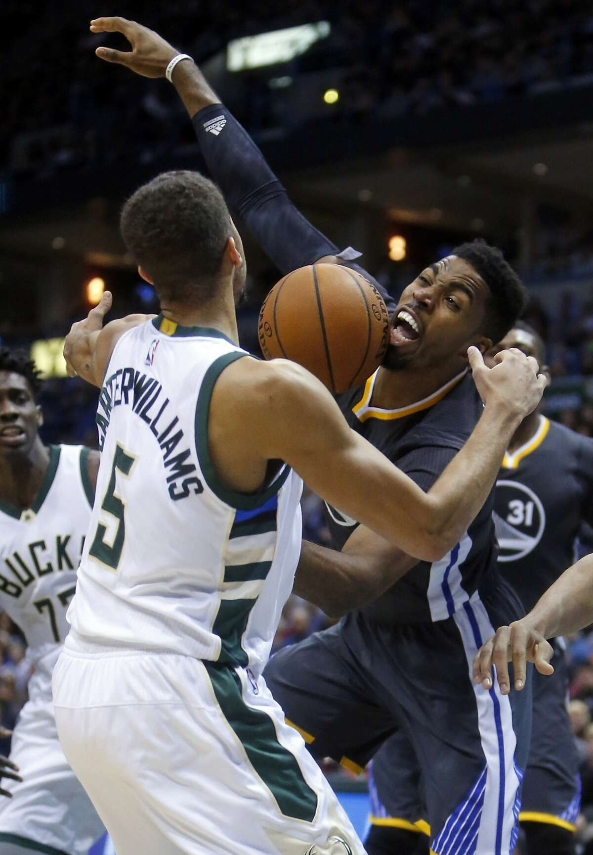 Golden State Warriors' Jason Thompson loses control of the ball against Milwaukee Bucks' Michael Carter-Williams during Milwaukee's 108-95 win in NBA game at BMO Harris Bradley Center in Milwaukee, WI on Saturday, December 12, 2015.