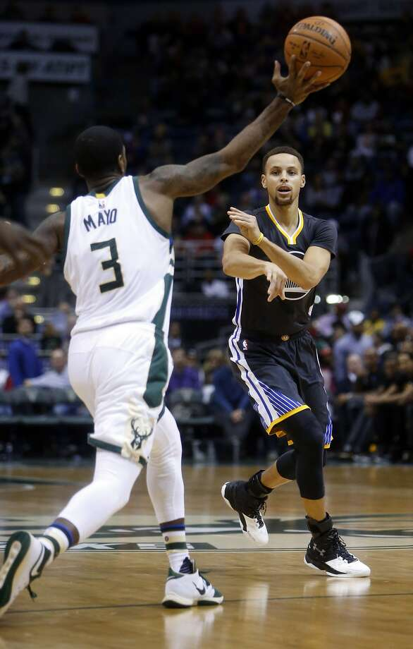 Golden State Warriors' Stephen Curry has a pass stolen by Milwaukee Bucks' O.J. Mayo during 3rd quarter of Milwaukee's 108-95 win in NBA game at BMO Harris Bradley Center in Milwaukee, WI on Saturday, December 12, 2015. Photo: Scott Strazzante, The Chronicle