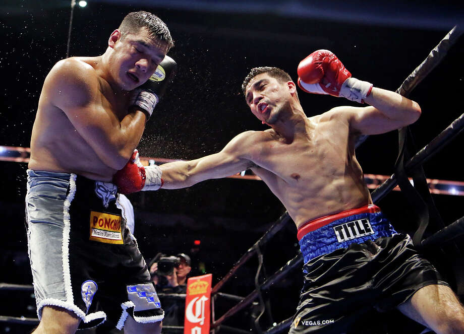 Omar Figueroa Jr. (left) is hit by Antonio DeMarco during their super welterweight bout part of the Premier Boxing Champions card Saturday Dec. 12, 2015 at the AT&T Center. Photo: Edward A. Ornelas, Staff / San Antonio Express-News / © 2015 San Antonio Express-News