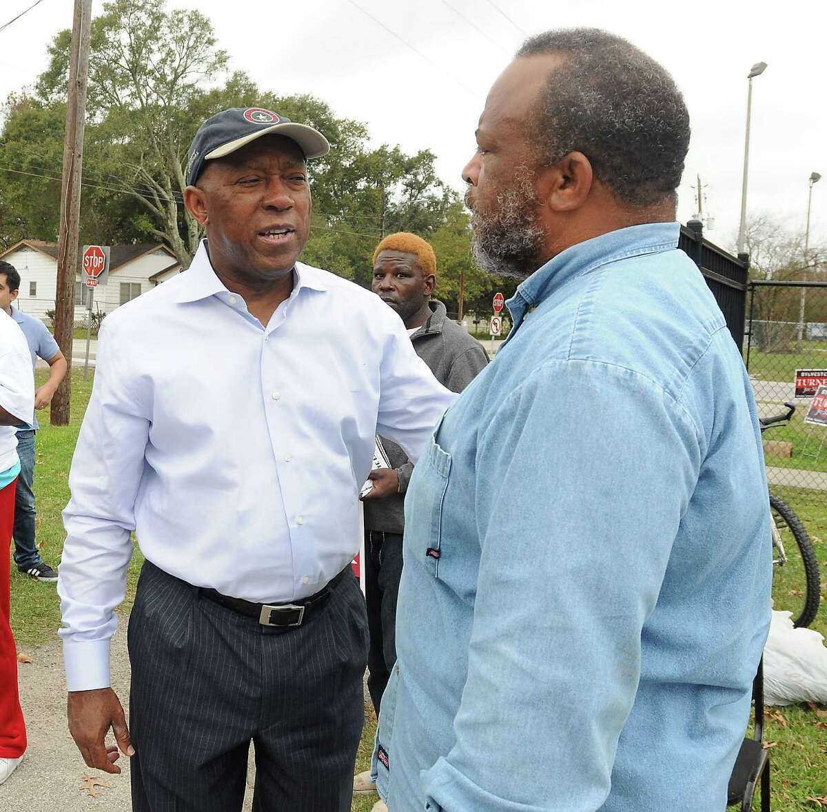 Mayoral candidate Sylvester Turner does some last minute hand-shaking outside Osborne Elementary School Saturday Dec. 12, 2015.(Dave Rossman photo)