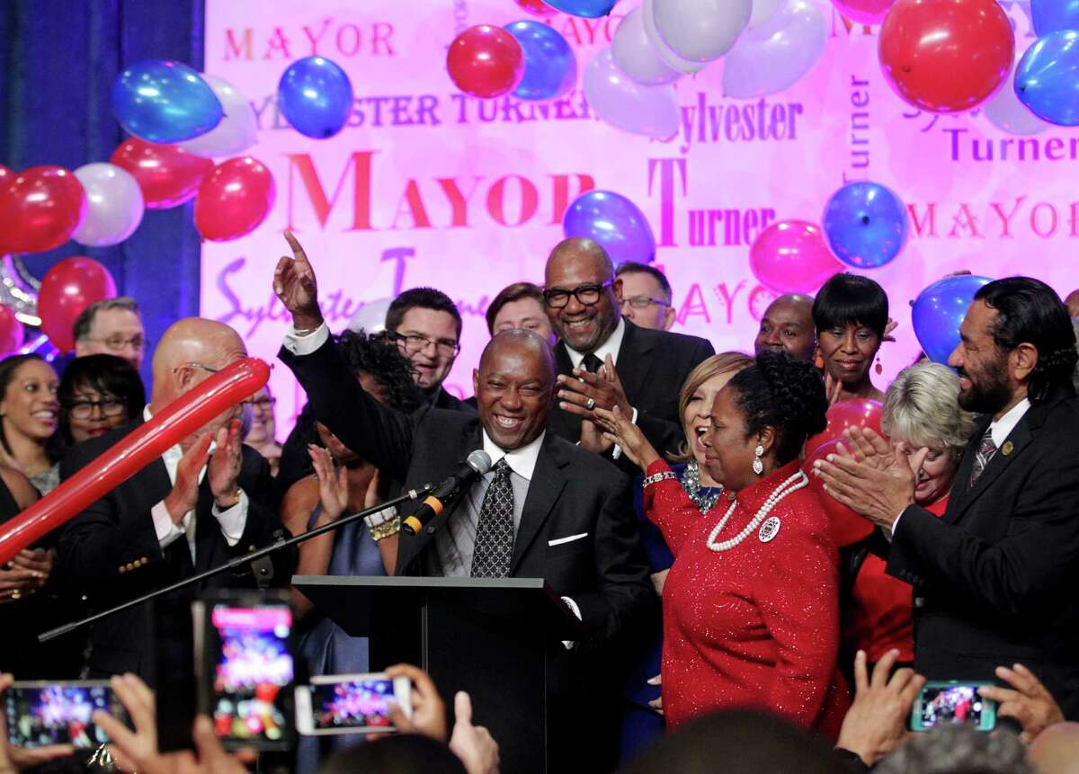 Mayor-elect Sylvester Turner celebrates his victory at his election night watch party at the George R. Brown Convention Center.