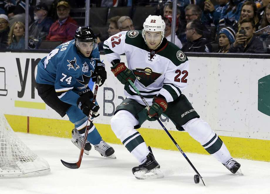 Minnesota Wild's Nino Niederreiter (22) is chased by San Jose Sharks' Dylan DeMelo (74) during the second period at SAP Center. The Wild broke the scoreless tie early in the third period. Photo: Marcio Jose Sanchez, Associated Press