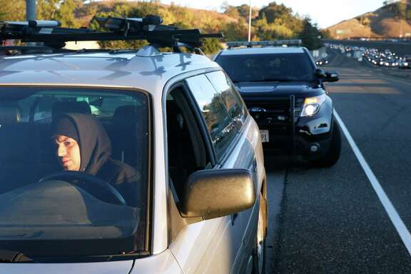 Eddie Servin is pulled over by California Highway Patrol Officer Andrew Barclay for driving solo in a carpool lane on southbound Highway 101 in San Rafael.