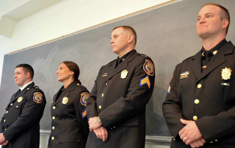 Four police officers were promoted in rank Friday afternoon including, from left (with their new rank), Lt. Anthony Prezioso, Sgt. Sereniti Dobson, Sgt. Richard Bagley and Sgt. Robert Myer. Photo: Jarret Liotta / For Hearst Connecticut Media / Westport News
