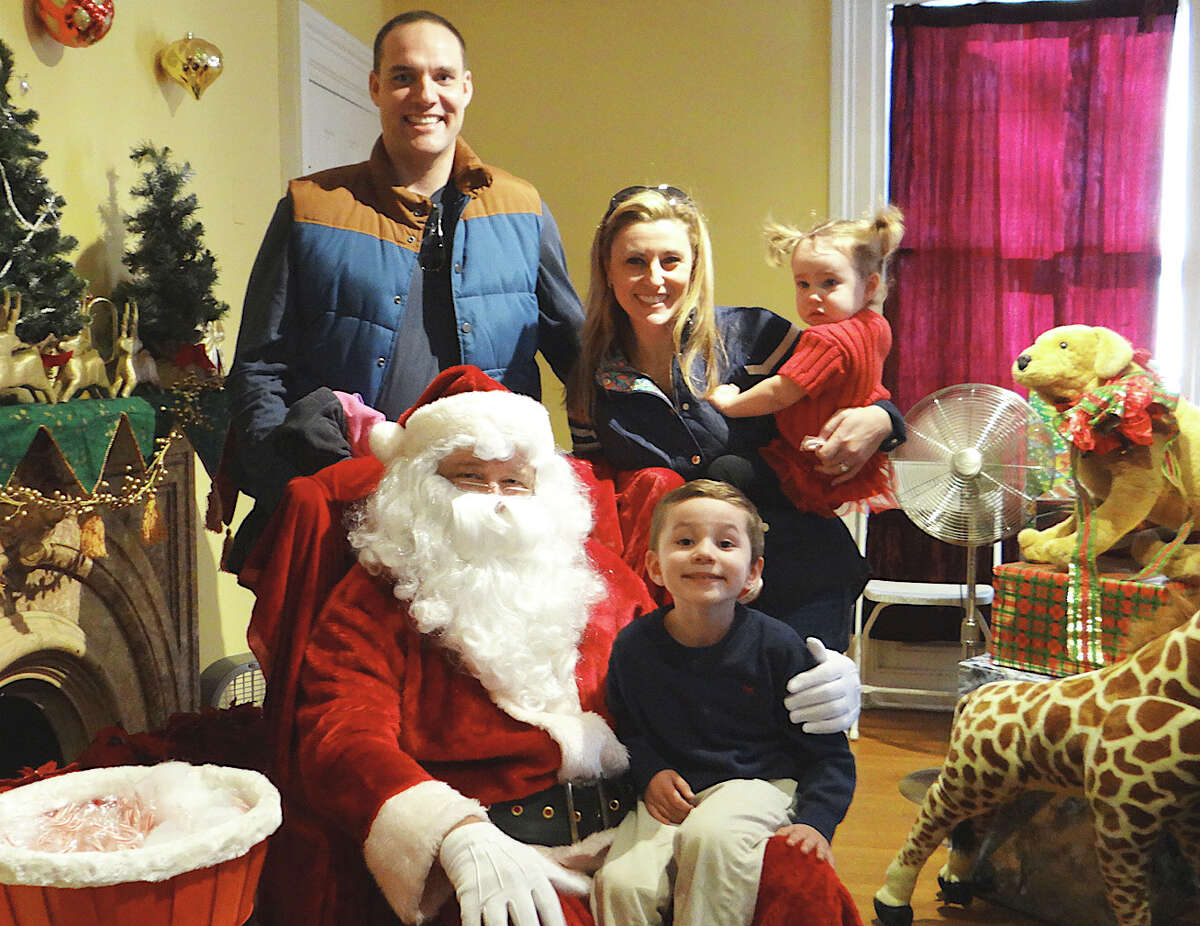 The Wagner family -- Ryan, Jennifer, Brayden, 4, and Hailey, 2 -- pose with Santa Claus at