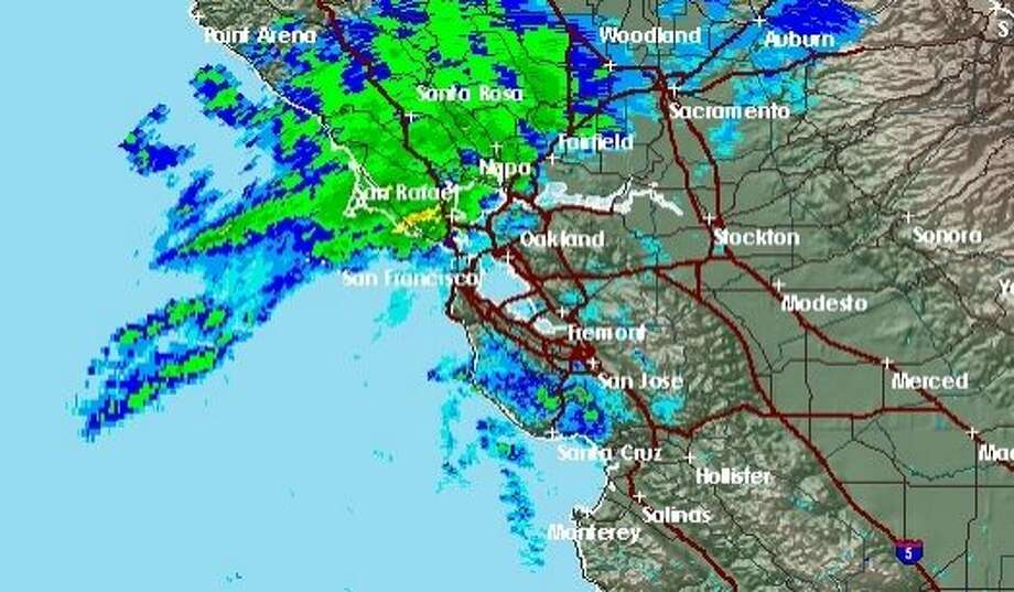 A heavy band of rain was on track to sweep through the Bay Area early Sunday morning before winds whip up in the afternoon. Photo: NWS
