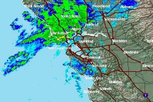 A heavy band of rain was on track to sweep through the Bay Area early Sunday morning before winds whip up in the afternoon.