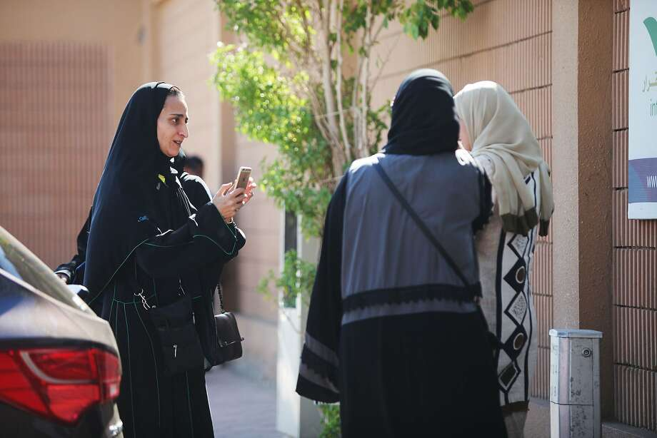 Women snap photos as they arrive at their polling station in Jiddah to vote in municipal elections. Photo: Jordan Pix, Getty Images