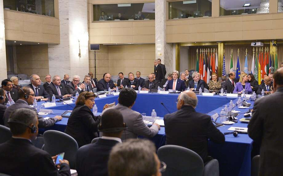 U.S. Secretary of State John Kerry (center, rear) and Italian Foreign Minister Paolo Gentiloni (on Kerry's left) hosted the conference in Rome. Photo: Mandel Ngan, AFP / Getty Images