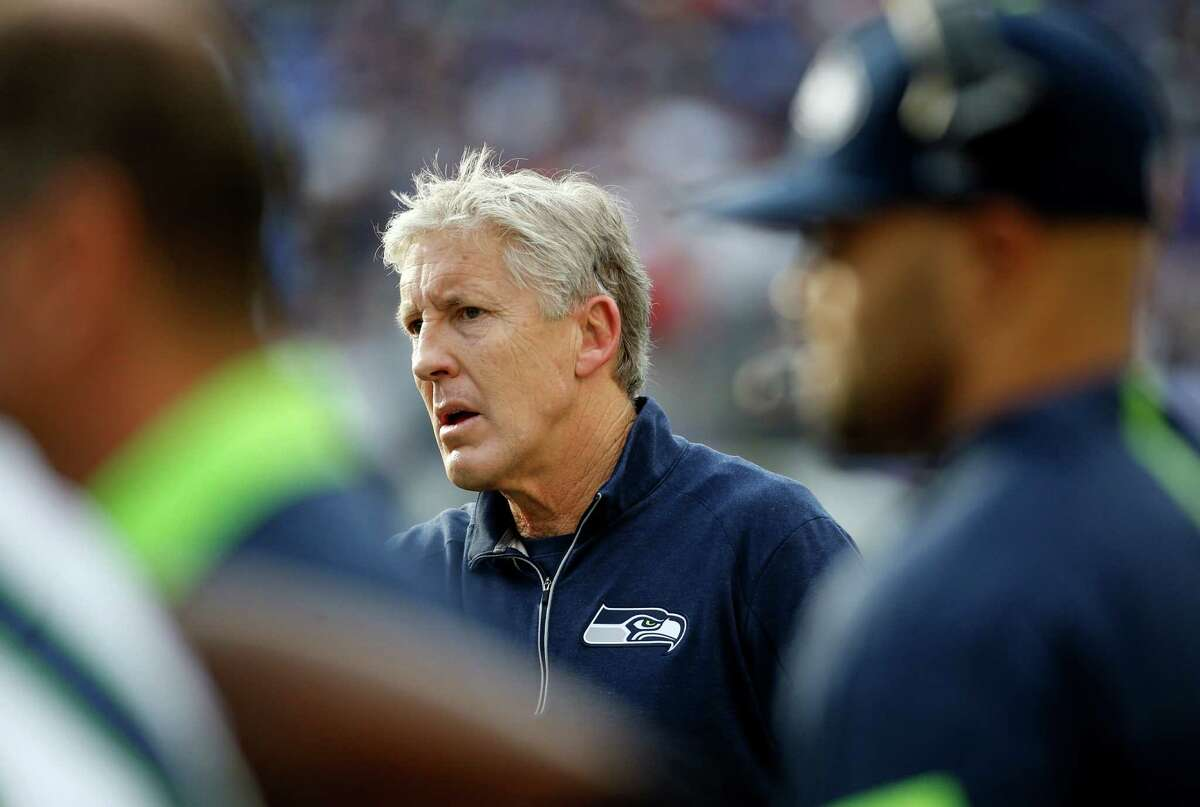 Seattle Seahawks head coach Pete Carroll reacts during the first half an NFL football game against the Baltimore Ravens, Sunday, Dec. 13, 2015, in Baltimore. (AP Photo/Patrick Semansky)