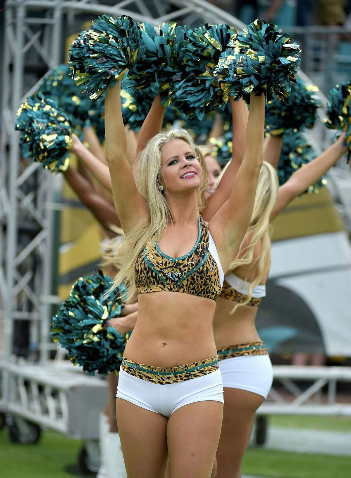 Jacksonville Jaguars cheerleaders perform during the first half of an NFL football game against the Indianapolis Colts in Jacksonville, Fla., Sunday, Dec. 13, 2015.(AP Photo/Phelan M. Ebenhack)