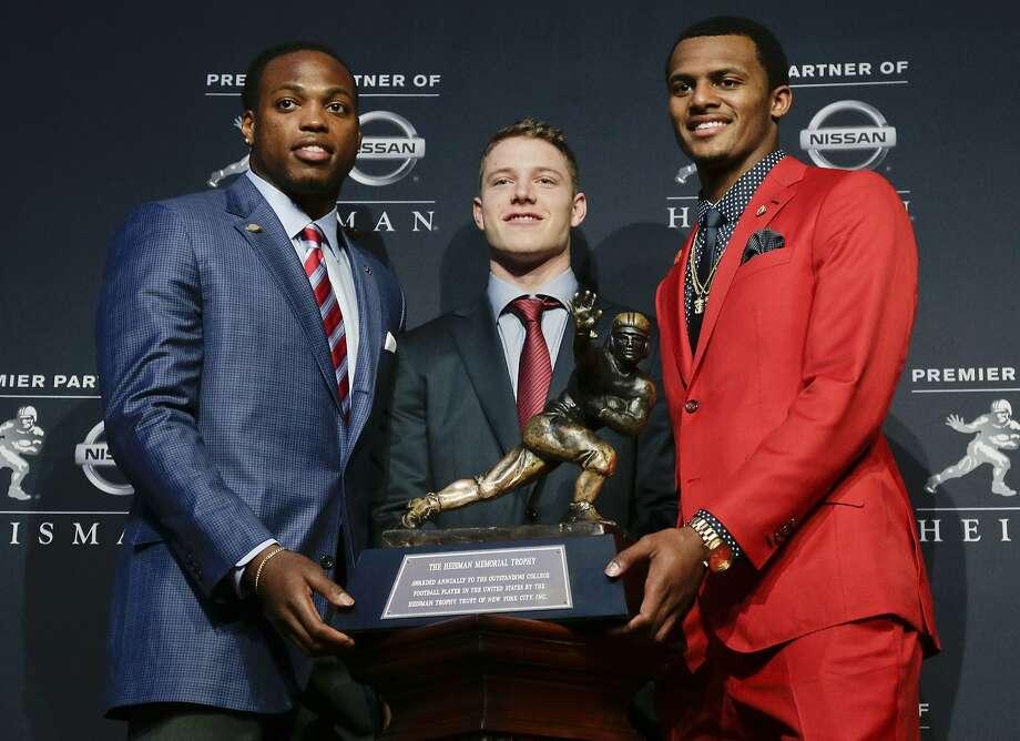 Heisman Trophy winner Derrick Henry (left) poses with fellow finalists Christian McCaffrey (center) of Stanford and Clemson's Deshaun Watson. Photo: Julie Jacobson, Associated Press
