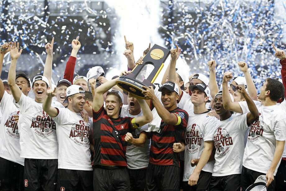 The Stanford men's soccer team celebrates after winning the NCAA College Cup championship soccer match after beating Clemson 4-0 on Sunday in Kansas City, Kan. Photo: Colin E. Braley, Associated Press