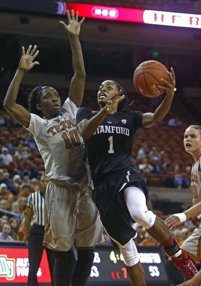 Stanford guard Lili Thompson, who had 21 points, drives to the basket against Texas guard Lashann Higgs. Photo: Michael Thomas, Associated Press