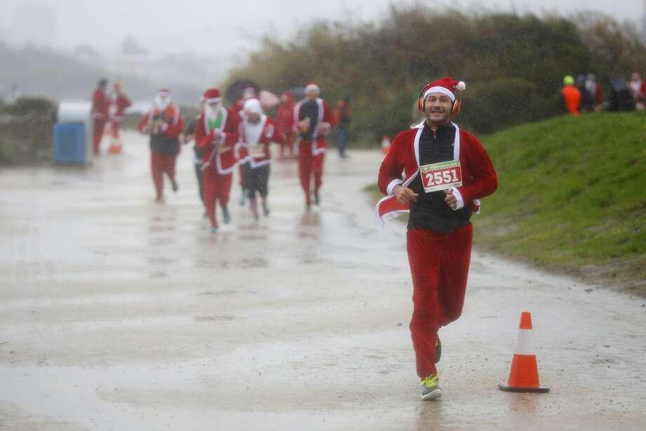 Ben Morino runs a 5K at The Great Santa Run at Crissy Field in San Francisco, California, on Sunday Dec. 13, 2015. Photo: Connor Radnovich, The Chronicle