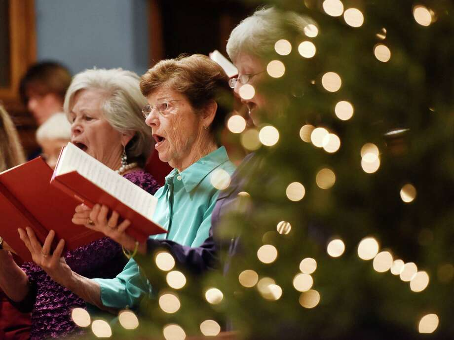 Nancy Pearson and other members of the First Church Festival Chorus sing during the 49th annual holiday performance of HandelâÄôs âÄúMessiahâÄù at First Congregational Church of Greenwich in Old Greenwich, Conn. Sunday, Dec. 13, 2015.  Presented by FCCOG and The First Music and Arts Series, the performance featured the First Church Festival Chorus and Chamber Orchestra, as well as four professional vocal soloists. Photo: Tyler Sizemore, Hearst Connecticut Media / Greenwich Time