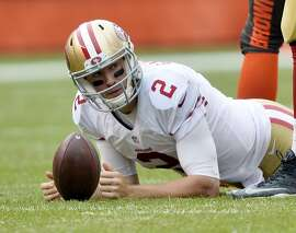 San Francisco 49ers quarterback Blaine Gabbert (2) reacts after being sacked during the first half of an NFL football game against the Cleveland Browns, Sunday, Dec. 13, 2015, in Cleveland. (AP Photo/David Richard)
