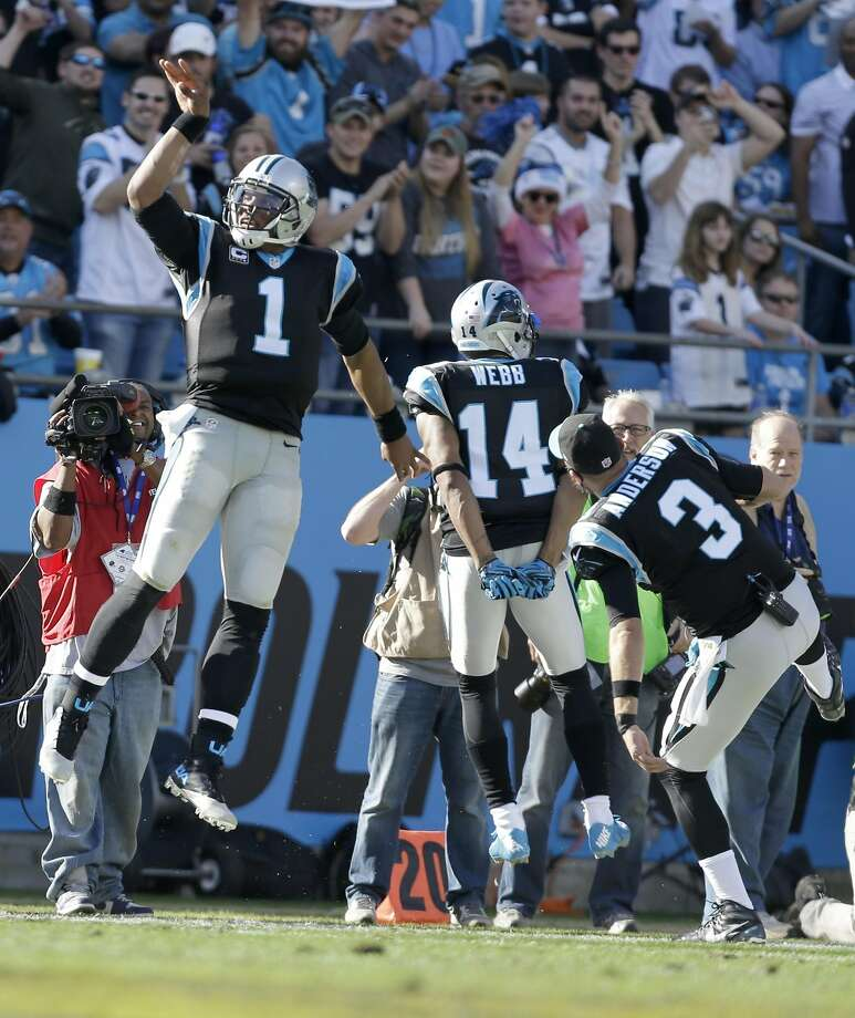 Carolina Panthers' Cam Newton (1) celebrates a touchdown against the Atlanta Falcons with Derek Anderson (3) and Joe Webb (14) in the first half of an NFL football game in Charlotte, N.C., Sunday, Dec. 13, 2015. (AP Photo/Bob Leverone) Photo: Bob Leverone, Associated Press