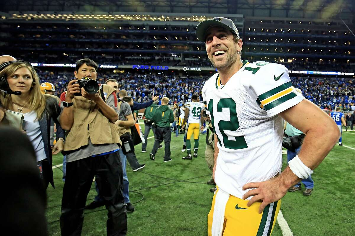 DETROIT, MI - DECEMBER 3: Quarterback Aaron Rodgers #12 of the Green Bay Packers celebrates after throwing the game winning touchdown pass with time expired to defeat the Detroit Lions 27-23 at Ford Field on December 3, 2015 in Detroit, Michigan. (Photo by Andrew Weber/Getty Images)