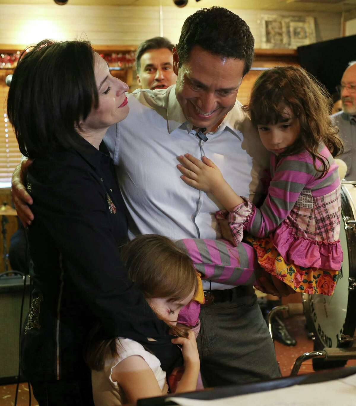 Surrounded by family, Texas State Representative Trey Martinez Fischer announces his candidacy for Texas Senate District District 26 at Henry's Puffy Tacos, Sunday, Dec. 13, 2015. For a second time, Martinez Fischer will face off with Sen. Jose Menendez for the seat vacated by Leticia Van De Putte. Menendez won the special election for the vacated seat in February of this year. With him is his wife, Elizabeth Marie and their two daughters, Francesca, lower left, and Camila.