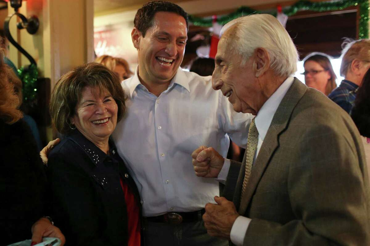 Texas State Representative Trey Martinez Fischer, center, greets Dr. William Elizondo and his wife, Maria Oralia, before Martinez Fischer announces his candidacy for Texas Senate District District 26, Sunday, Dec. 13, 2015. For a second time, Martinez Fischer will face off with Sen. Jose Menendez for the seat vacated by Leticia Van De Putte. Menendez won the special election for the vacated seat in February of this year.