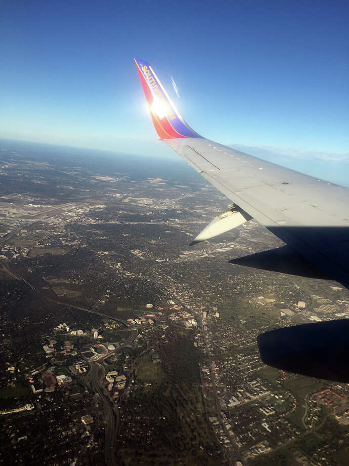 A passenger's photo of the damaged wing of a Southwest Airlines flight heading into San Antonio International Airport on Sunday, Dec. 13, 2015. Photo: Courtesy Jay Baker