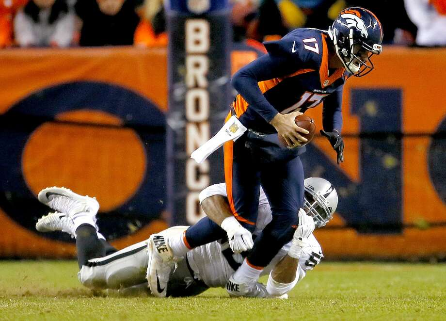 Oakland's Khalil Mack takes the low road to record one of his five sacks of Broncos quarterback Brock Osweiler. Photo: Joe Mahoney, Associated Press
