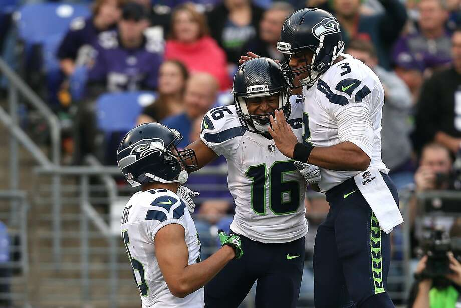 BALTIMORE, MD - DECEMBER 13: Wide receiver Tyler Lockett #16 of the Seattle Seahawks celebrates with teammates wide receiver Doug Baldwin #89 and quarterback Russell Wilson #3 after scoring a fourth quarter touchdown against the Baltimore Ravens at M&T Bank Stadium on December 13, 2015 in Baltimore, Maryland. (Photo by Patrick Smith/Getty Images) Photo: Patrick Smith, Getty Images