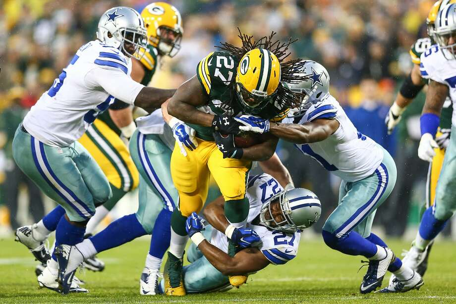Packers running back Eddie Lacy, who rushed for 124 yards, is tackled by J.J. Wilcox (27) in the first half. Photo: Ronald Martinez, Getty Images