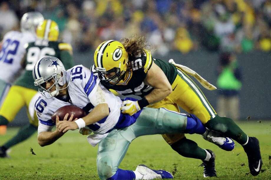 Green Bay Packers' Clay Matthews sacks Dallas Cowboys' Matt Cassel during the second half of an NFL football game Sunday, Dec. 13, 2015, in Green Bay, Wis. (AP Photo/Jeffrey Phelps) Photo: Jeffrey Phelps, FRE / Associated Press / FR59249 AP