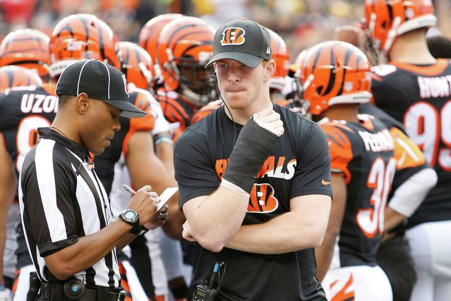 Bengals QB Andy Dalton walks the sidelines in a cast after breaking his thumb Sunday. Photo: Frank Victores, FRE / FR170726 AP