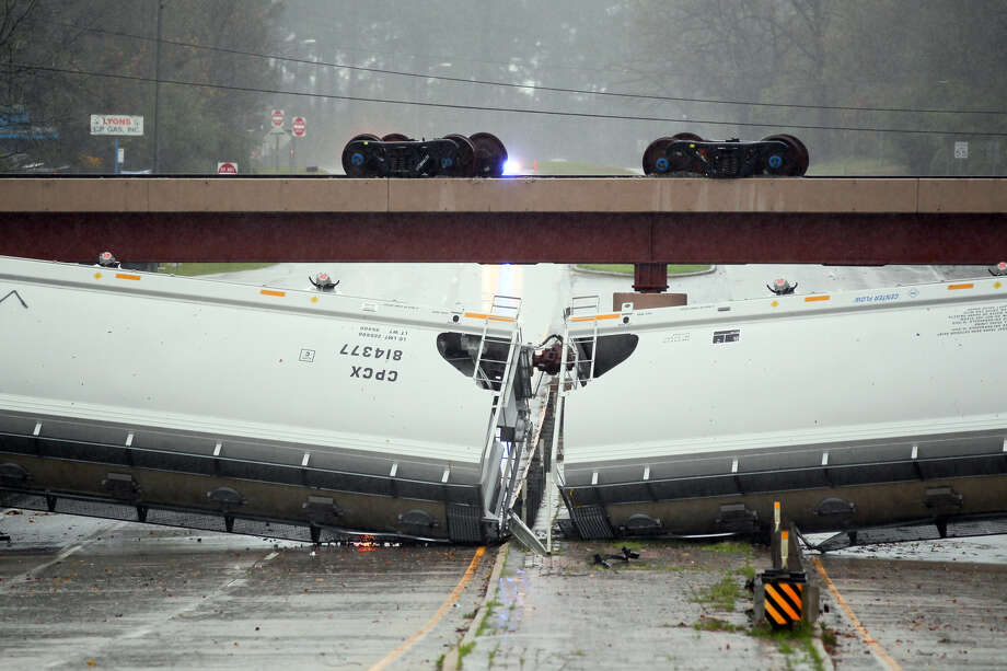 Rail cars are blown off the railroad trestle by straight-line winds on Sunday, across North John Redditt Drive, near the Pepsi plant in Lufkin. Photo: Andy Adams, MBR / The Daily News