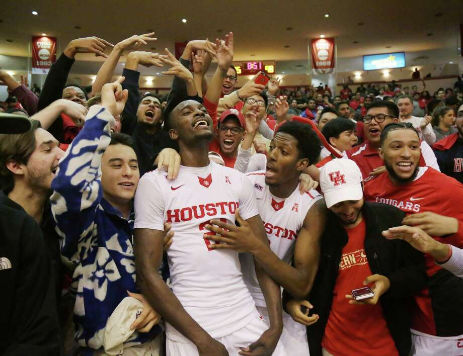 Houston Cougars forward Devonta Pollard (24) and forward Danrad Knowles (0) celebrate with fans after defeating LSU in overtime in a college basketball game at Hofheinz Pavillion Sunday, Dec. 13, 2015, in Houston. ( Jon Shapley / Houston Chronicle ) Photo: Jon Shapley, Staff / © 2015  Houston Chronicle