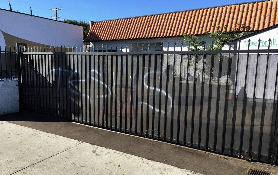 """Jesus"" was spray- painted on the iron fence at the Ahmadiyya Muslim Community Baitus- Salaam Mosque in Hawthorne, Calif. Photo: Ahmadiyya Muslim Community Muslimsforpeace.org /Associated Press / Ahmadiyya Muslim Community musli"