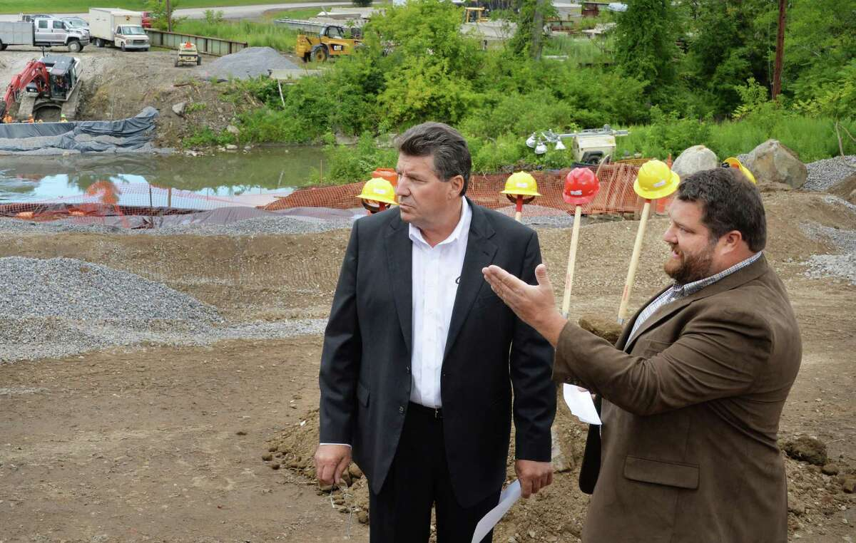 """Carver Laraway, left, owner of the Port of Coeymans and Coeymans' Supervisor Steve Flach during ground breaking ceremonies for a new bridge over the Coeymans Creek near the Port of Coeymans Thursday August 14, 2014, in Coeymans, NY. Flach narrowly lost in a contentious re-election as voters had concerns the supervisor was too favorable to Laraway. In March 2021, Flach - as head of Camp Pinnacle in New Scotland - hosted a """"constitutional liberty"""" event where Albany County Legislator George Langdon IV made homophobic comments. (John Carl D'Annibale / Times Union)"""