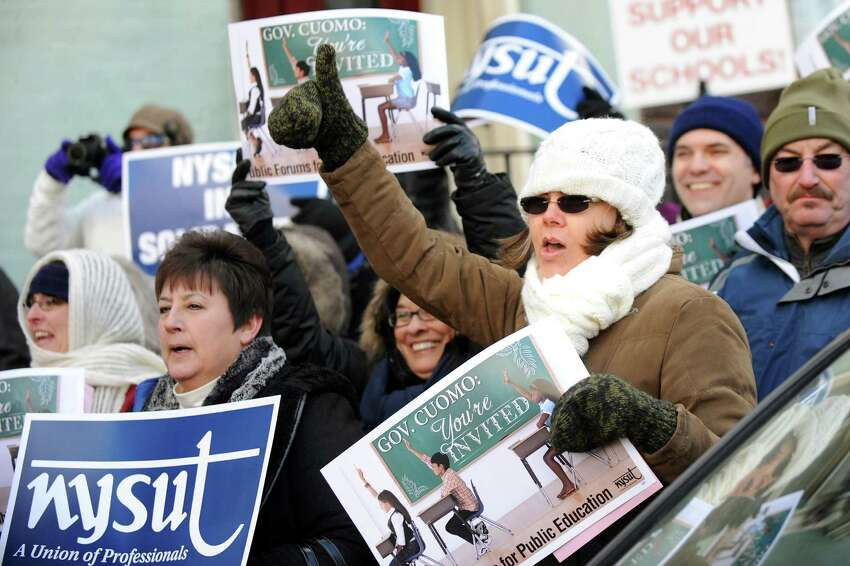 NYSUT members rally to protest Gov. Cuomo's school policies on Wednesday, Dec. 31, 2014, across the street from the Executive Mansion in Albany, N.Y. (Cindy Schultz / Times Union archive)
