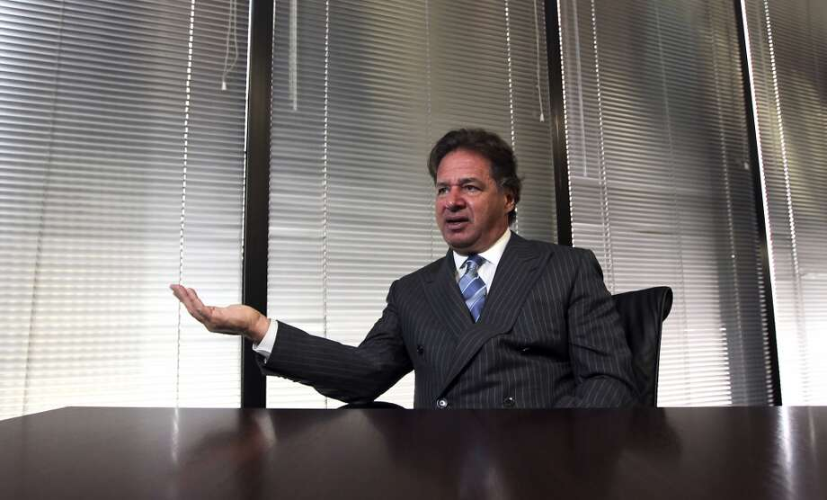 Charif Souki, CEO of Cheniere Energy speaks during an interview, Cheniere is among Houston's top workplaces, according to a Chronicle survey.  Continue clicking to see the highest paid CEOs in the energy industry. Photo: James Nielsen, Houston Chronicle