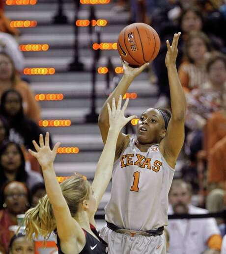 Texas guard Empress Davenport (1) puts up a shot for two of her career-best 23 points Sunday. Photo: Michael Thomas, FRE / FR65778 AP