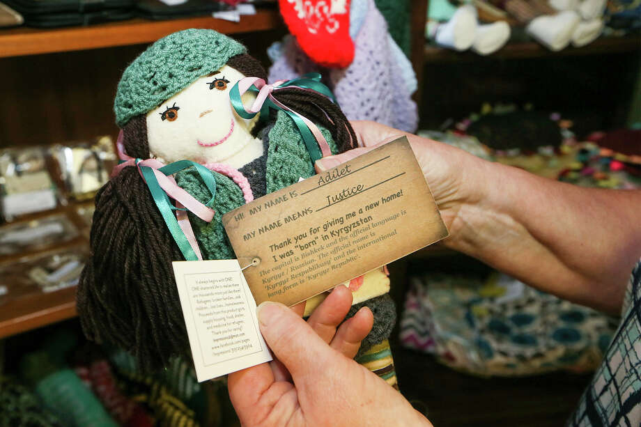 Jean Sherrill, business manager for the Center for Refugee Service's World Mosaic Market, 8703 Wurzbach, holds a handmade doll made in Kyrgystan on Friday, Dec. 11, 2015.  MARVIN PFEIFFER/ mpfeiffer@express-news.net Photo: Marvin Pfeiffer, San Antonio Express-News / Express-News 2015