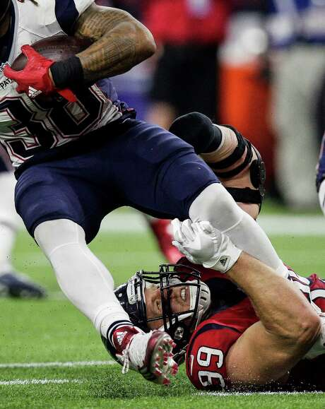 J.J. Watt pulls down Patriots running back Brandon Bolden on a lackluster night for the Texans' defensive end by his standards. Photo: Michael Ciaglo, Staff / © 2015  Houston Chronicle