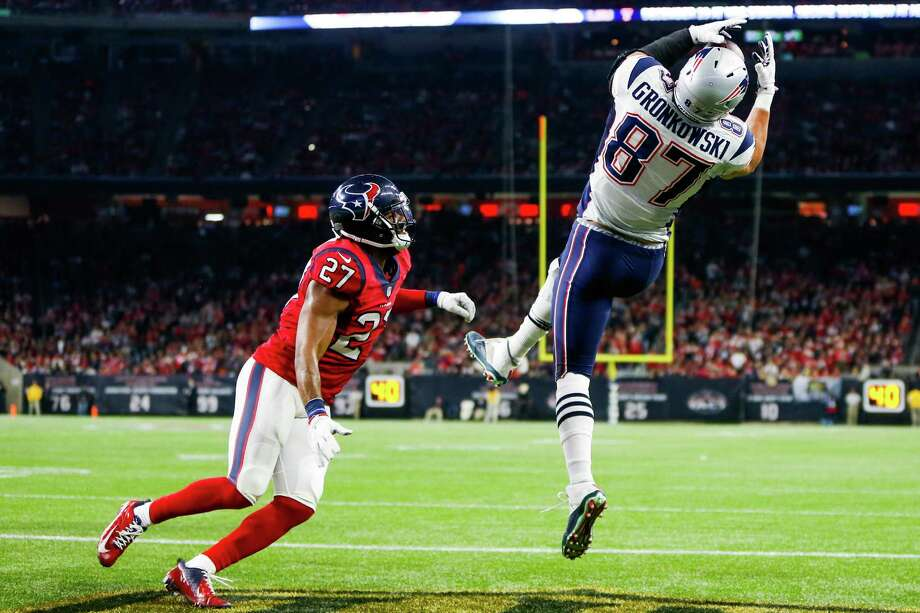 Patriots tight end Rob Gronkowski (87) was no match for Texans free safety Quintin Demps on this 1-yard touchdown off a lob pass from quarterback Tom Brady just before halftime Sunday night. Photo: Karen Warren, Staff / © 2015  Houston Chronicle